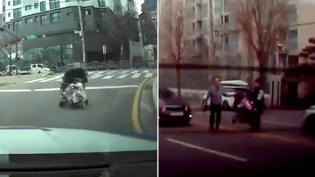 차 쌩쌩 달리는 도로 위로 미끄러져 내려가는 '유모차' 잡아 아이 구한 경찰